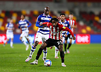 19th December 2020; Brentford Community Stadium, London, England; English Football League Championship Football, Brentford FC versus Reading; Tariqe Fosu of Brentford is challenged by Sone Aluko of Reading