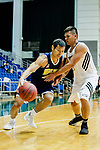 Fong Shing Yee #22 of Winling Basketball Club (L) dribbles the ball up court against Gonzalez Lau #10 of Eagle Basketball Team (R) during the Hong Kong Basketball League game between Eagle and Winling at Southorn Stadium on May 4, 2018 in Hong Kong. Photo by Yu Chun Christopher Wong / Power Sport Images