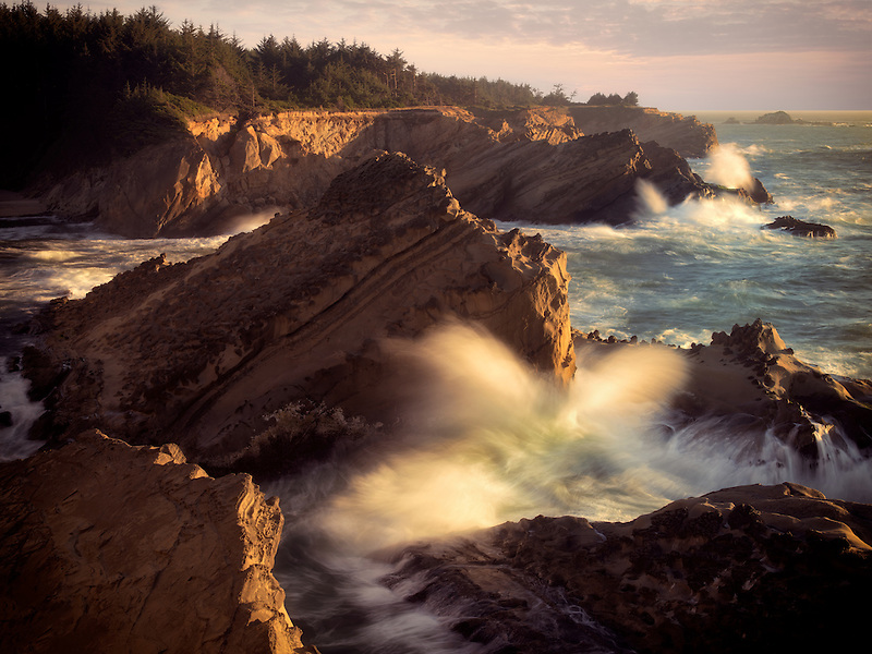 Waves and setting sun at Shore Acres State Park, Oregon