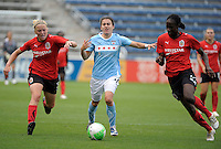 Chicago forward Karen Carney (14) is run off the ball by Atlanta midfielder Katie Larkin (5, left) and defender Tina Ellertson (23).  The Chicago Red Stars tied the Atlanta Beat 0-0 at Toyota Park in Bridgeview, IL on June 6, 2010.