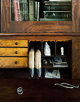 An eclectic collection of objets in a veneered bureau