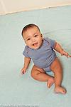 6 month old baby girl portrait sitting full length