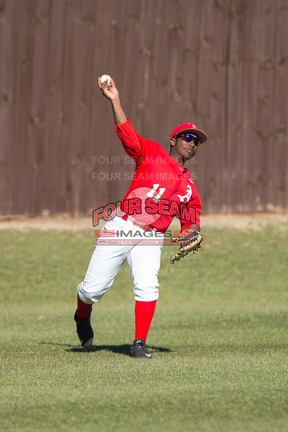 Belmont Abbey Crusaders left fielder Levi Wright (11) throws the baseball back to the infield during the game against the Shippensburg Raiders at Abbey Yard on February 8, 2015 in Belmont, North Carolina.  The Raiders defeated the Crusaders 14-0.  (Brian Westerholt/Four Seam Images)
