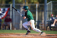 Dartmouth Big Green second baseman Sean Sullivan (4) hits a single during a game against the Northeastern Huskies on March 3, 2018 at North Charlotte Regional Park in Port Charlotte, Florida.  Northeastern defeated Dartmouth 10-8.  (Mike Janes/Four Seam Images)