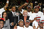 The Alabama State Hornets team getting their trophy after winning the SWAC Championship game between the Alabama State Hornets and the Grambling State Tigers at the Special Events Center in Garland, Texas. Alabama State defeats Grambling State 65 to 48.