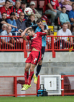 Michael Harriman of Wycombe Wanderers wins the header from Gwion Edwards of Crawley Town during the Sky Bet League 2 match between Crawley Town and Wycombe Wanderers at Checkatrade.com Stadium, Crawley, England on 29 August 2015. Photo by Liam McAvoy.