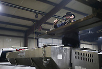 Derek Andert outfits a salt spreader to the bed of a truck, Friday, February 12, 2021 at the Benton County Roads Department in Bentonville. Check out nwaonline.com/210213Daily/ for today's photo gallery. <br /> (NWA Democrat-Gazette/Charlie Kaijo)