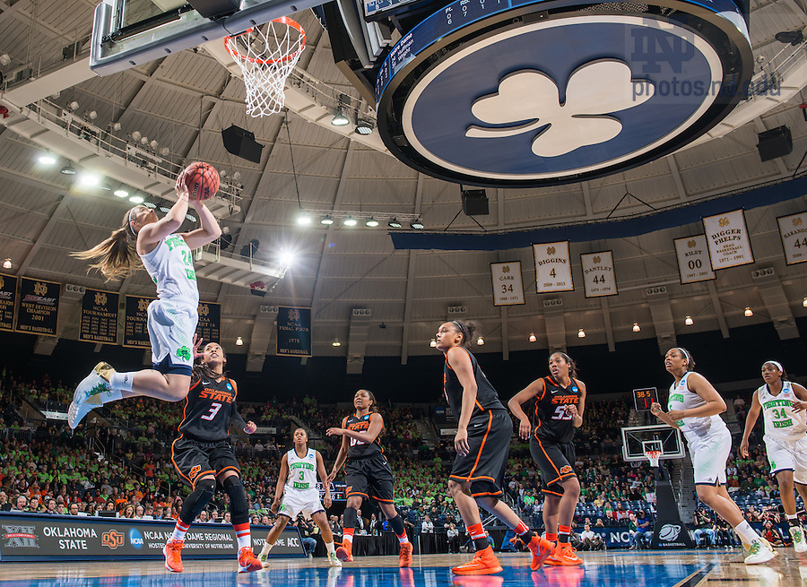 Mar 29, 2014; Hannah Huffman (24) goes up for a shot in front of Oklahoma State Cowgirls guard Tiffany Bias (3) defends in the regional semifinal game against Oklahoma State. Notre Dame won 89-72. <br /> <br /> Photo by Matt Cashore