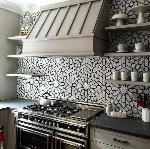 Castilla, a waterjet and hand-cut stone mosaic, shown in honed Jura Grey and polished Calacatta Tia, is part of the Miraflores Collection by Paul Schatz for New Ravenna.<br /> <br /> Photo courtesy of <br /> Buckingham Interiors & Designs: http://buckinghamid.com/<br /> and Fine Line: http://www.finelinetile.com/