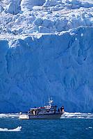 Tourists view tidewater glacier, Kenai Fjords National Park, Alaska