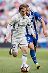 Luka Modric of Real Madrid is followed by Bernard Francois Hernandez Pi, Theo Hernandez, of Deportivo Alaves during their La Liga match between Real Madrid and Deportivo Alaves at the Santiago Bernabeu Stadium on 02 April 2017 in Madrid, Spain. Photo by Diego Gonzalez Souto / Power Sport Images
