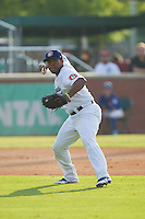 Chattanooga Lookouts third baseman Daniel Mayora (17) makes a throw to first base against the Montgomery Biscuits at AT&T Field on July 24, 2014 in Chattanooga, Tennessee.  The Biscuits defeated the Lookouts 6-4. (Brian Westerholt/Four Seam Images)