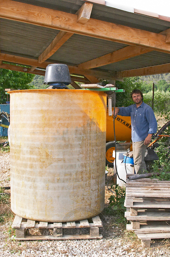 Christophe Peyrus Domaine Clos Marie. Pic St Loup. Languedoc. A bio-dynamic dynamiser dynamiseur to make herbal infusions by stirring a mix of plants and herbs in water. Owner winemaker. France. Europe.