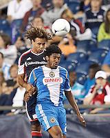 New England Revolution defender Kevin Alston (30) and Philadelphia Union defender Sheanon Williams (25) battle for head ball. In a Major League Soccer (MLS) match, the New England Revolution tied Philadelphia Union, 0-0, at Gillette Stadium on September 1, 2012.