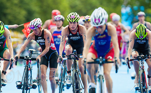 04 AUG 2012 - LONDON, GBR - Helen Jenkins (GBR) of Great Britain (centre, #10, in dark blue and white) exits transition for the start of the bike during the women's London 2012 Olympic Games Triathlon in Hyde Park, London, Great Britain (PHOTO (C) 2012 NIGEL FARROW)