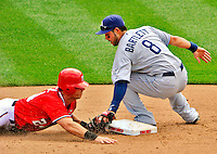 29 May 2011: San Diego Padres infielder Jason Bartlett in unable to get Washington Nationals center fielder Rick Ankiel out at second in the bottom of the 5th inning at Nationals Park in Washington, District of Columbia. The Padres defeated the Nationals 5-4 to take the rubber match of their 3-game series. Mandatory Credit: Ed Wolfstein Photo