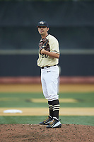 Wake Forest Demon Deacons relief pitcher Ben Casstevens (20) looks to his catcher for the sign against the Miami Hurricanes at David F. Couch Ballpark on May 11, 2019 in  Winston-Salem, North Carolina. The Hurricanes defeated the Demon Deacons 8-4. (Brian Westerholt/Four Seam Images)