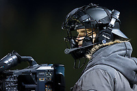 The TV camera man stationed on top of the first base dugout wears a catchers mask for protection during the ACC baseball game between the Florida State Seminoles and the Wake Forest Demon Deacons at David F. Couch Ballpark on March 9, 2018 in  Winston-Salem, North Carolina.  The Seminoles defeated the Demon Deacons 7-3.  (Brian Westerholt/Four Seam Images)