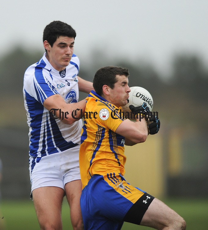 Shane Aherne of Waterford in action against Mark Mc Carthy of Clare in action during their national league game at Miltown Malbay. Photograph by John Kelly.