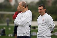 USMNT Head Coach Bob Bradley (l) observes training alongside Assistant Coach Peter Nowak (r)..