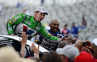 Sept. 30, 2012; Madison, IL, USA: NHRA funny car winner Jack Beckman (left) and top fuel winner Antron Brown celebrate with fans after winning the Midwest Nationals at Gateway Motorsports Park. Mandatory Credit: Mark J. Rebilas-