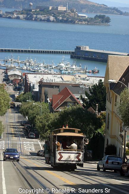 SAN FRANCISCO TROLLEY CAR WITH ALCATRAZ IN DISTANCE