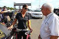 May 31, 2013; Englishtown, NJ, USA: NHRA top fuel dragster driver Leah Pruett (left) talks to ESPN announcer Gary Gerould during qualifying for the Summer Nationals at Raceway Park. Mandatory Credit: Mark J. Rebilas-
