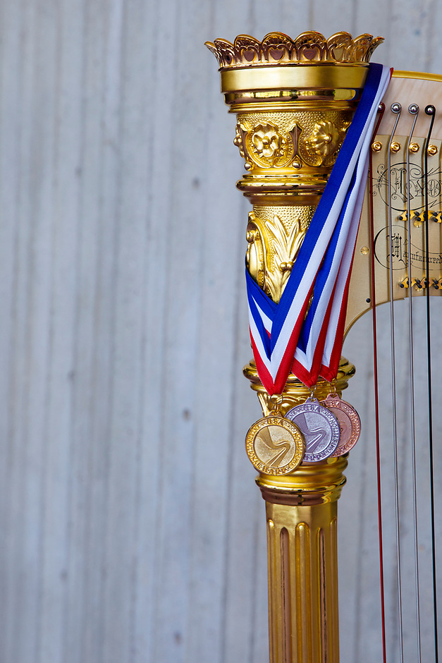 The gold, silver and bronze medals are pictured with the Lyon and Healy Concert Grand Harp during the 11th USA International Harp Competition at Indiana University in Bloomington, Indiana on Saturday, July 13, 2019. (Photo by James Brosher)