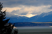 Snow capped Canadian Rockies in British Columbia looking across Lake Koocanusa in Montana