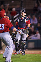 Columbus Clippers catcher Adam Moore (25) looks on as Giovanny Urshela (23) catches a popup in foul territory during a game against the Rochester Red Wings on June 14, 2016 at Frontier Field in Rochester, New York.  Rochester defeated Columbus 1-0.  (Mike Janes/Four Seam Images)