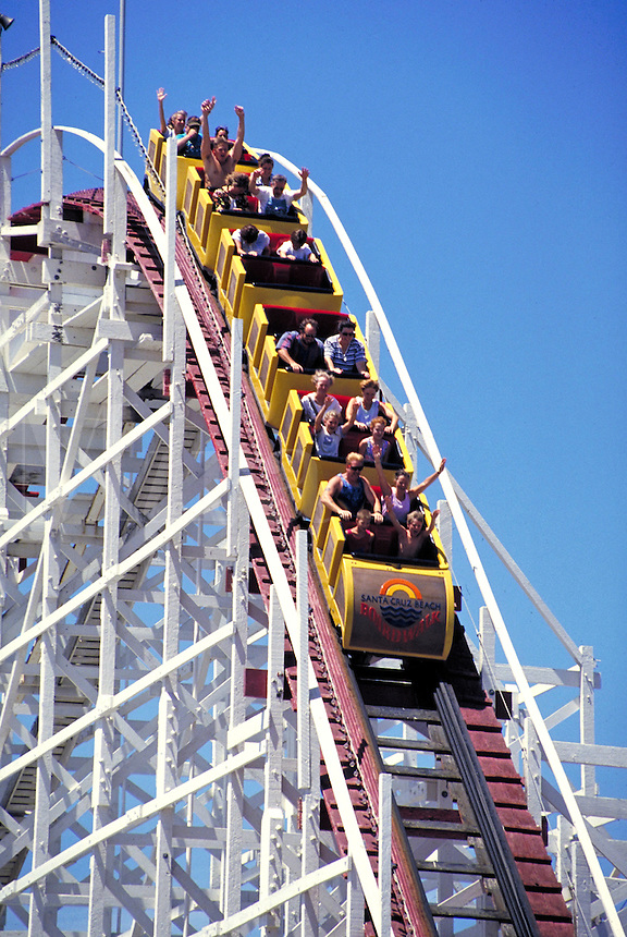 "Big Dipper"""" wooden roller coaster with riders. Amusement park ride. people. Santa Cruz California USA."