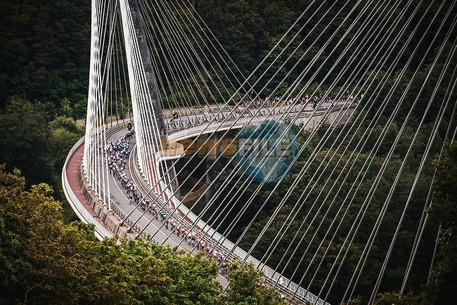 The peloton cross Pont de Terenez during Stage 1 of the 2021 Tour de France, running 197.8km from Brest to Landerneau, France. 26th June 2021.  <br /> Picture: A.S.O./Charly Lopez | Cyclefile<br /> <br /> All photos usage must carry mandatory copyright credit (© Cyclefile | A.S.O./Charly Lopez)