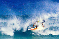 A surfer rides the tube off the north shore of Oahu.
