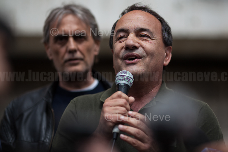 """Mimmo Lucano.<br /> <br /> Rome, 13/05/2019. Today, the suspended Mayor of Riace, Domenico 'Mimmo' Lucano (1.) was the main guest of a public seminary at the University of Rome La Sapienza called """"Living together - The sense of places and the meaning of others. Riace to be shared"""". The event was held in the historical Aula 1 of the Faculty of Literature & Philosophy. Co-host of the seminary was Vito Veti (Professor of Cultural Anthropology at University of Calabria). The 'Long Day' of La Sapienza started with a march in the campus held by thousands of antifascist students and members of the public gathered to block the neo-fascist organization """"forza nuova"""" which had planned to hold in Aldo Moro's Square (outside the main gate of the University) a counter event - banned by the police - with the slogan """"Mimmo Lucano is the enemy of Italy"""". The small group of neo-fascists were kept away from the University by police, Mimmo Lucano was escorted and protected by a river of people, and the Conference was held peacefully in a packed Aula 1.<br /> Domenico 'Mimmo' Lucano is accused, and banned on residing in Riace, over his alleged involvement in: organising """"marriages of convenience"""", overtaking immigration regulations, having allegedly allocated the garbage collection service to two companies of migrants using donkeys without going through the public procurement procedure.<br /> <br /> Footnotes & Links<br /> 1. My Stories, more info about Riace & Mimmo Lucano:<br /> 04.08.18 Riace Città Dell'Accoglienza: All Human Beings Are Welcome Here https://bit.ly/2Dw5yiK<br /> 05.08.18 The Riace Bronzes https://bit.ly/2oBoFNY<br /> 02.10.18 Support & Solidarity With Mayor of Riace Domenico Lucano https://bit.ly/2yhDryV<br /> 10.11.18 Uniti Contro Il Governo, Il Razzismo E Il Decreto Salvini - Demo https://bit.ly/2zkFEKk<br /> 30.01.19 Press Conference For Riace Nobel Peace Prize 2019 http://bit.do/eStrm<br /> """"Bella Ciao"""" & Video of the day (Source, Repubblica.it) http://bit.do/eSs"""