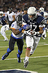 Nevada's Jarred Gipson (47) scores against Boise State's Dylan Sumner-Gardner (29) during the first half of an NCAA college football game in Reno, Nev, on Saturday, Oct. 4, 2014. (AP Photo/Cathleen Allison)