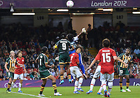 July 31, 2012..South Africa's Thokozile Mndaweni (18) and Amanda Dlamini (9) defend against Japan attack during Group F Women's Football match between JPN and RSA at the Millennium Stadium on day four of 2012 Olympic Games in Cardiff, United Kingdom...