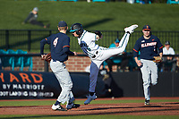 Nick Lucky (6) of the Coastal Carolina Chanticleers goes airborne trying to avoid the tag of Illinois Fighting Illini third baseman CamMcDonald (4) at Springs Brooks Stadium on February 22, 2020 in Conway, South Carolina. The Fighting Illini defeated the Chanticleers 5-2. (Brian Westerholt/Four Seam Images)