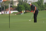 Dubai World Championship Golf. Earth Course,.Jumeirah Golf Estate, Dubai, U.A.E...Adam Scott playing his third shot on the 1st during the second round of the Dubai World Golf championship..Photo: Fran Caffrey/www.golffile.ie...