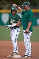 USF Bulls Alex Bello (33) and coach Brian Jeroloman during a game against the Dartmouth Big Green on March 17, 2019 at USF Baseball Stadium in Tampa, Florida.  USF defeated Dartmouth 4-1.  (Mike Janes/Four Seam Images)