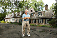 NEW JERSEY - SUNDAY FOR MONDAY:  Tenafly, NJ Mayor Peter Rustin is trying to save the town's largest property, a 1920's stone mansion and the 6.5 acres it sits on, from the hands of a developer who wants to divvy up the property into ten parcels and sell them for $2 million each.  Address:  53 Knickerbocker Road, Tenafly, NJ.<br /> <br /> PICTURED:   Mayor Peter Rustin, 67, stands in front of the mansion.<br /> <br /> (Angel Chevrestt, 646.314.3206)