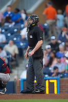 Home plate umpire Carlos Torres during the International League game between the Scranton/Wilkes-Barre RailRiders and the Durham Bulls at Durham Bulls Athletic Park on May 15, 2015 in Durham, North Carolina.  The RailRiders defeated the Bulls 8-4 in 11 innings.  (Brian Westerholt/Four Seam Images)