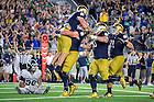September 17, 2016; Tight end Durham Smythe (80) celebrates a touchdown against Michigan State. (Photo by Matt Cashore)