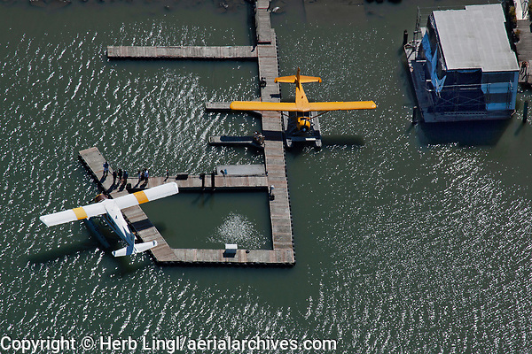 Two DeHavilland Beavers, both DHC-2 MK 1 models, N5220G and N123JL, docked at the piers at the Commodore Center Seaplane Base (22CA) in Sausalito, Marin County, California