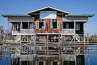 Myanmar, Burma.  Nursery School Building on Stilts.   Inle Lake, Shan State.