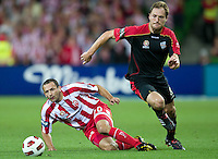 MELBOURNE, AUSTRALIA - NOVEMBER 19: Josip Skoko of the Heart and Adam Hughes of Adelaide in action during the round 15 A-League match between the Melbourne Heart and Adelaide United at AAMI Park on November 19, 2010 in Melbourne, Australia (Photo by Sydney Low / Asterisk Images)