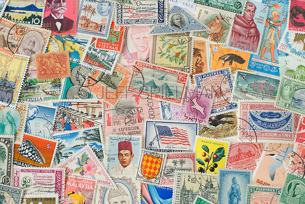 Assortment of Colorful Old Postage Stamps from Various Countries Around the World.<br /> <br /> AVAILABLE FOR COMMERCIAL OR EDITORIAL LICENSING FROM PLAINPICTURE.COM.  Please go to www.plainpicture.com and search for image # p569m791796.
