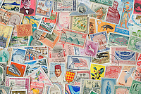Assortment of Colorful Old Postage Stamps from Various Countries Around the World.<br />