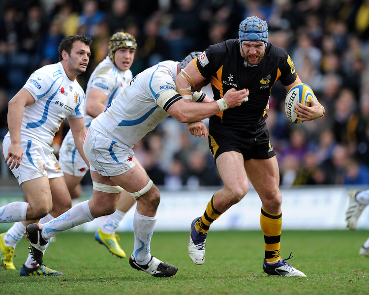 James Haskell of London Wasps is tackled by Richard Baxter of Exeter Chiefs during the Aviva Premiership match between London Wasps and Exeter Chiefs at Adams Park on Sunday 21st April 2013 (Photo by Rob Munro)