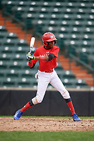 Roberto Martinez (5) swings at a pitch during the Dominican Prospect League Elite Underclass International Series, powered by Baseball Factory, on July 21, 2018 at Schaumburg Boomers Stadium in Schaumburg, Illinois.  (Mike Janes/Four Seam Images)