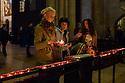 Lisbboa, UK. 04.05.2015. People light candles within the Se de Lisboa (Lisbon Cathedral). Photograph © Jane Hobson.